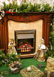 Fireplace. Artificial fireplace in an environment of New Year's toys royalty free stock photo