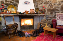 Fireplace. A fireplace in a rural home with shoes and boots drying close to the heat Royalty Free Stock Images