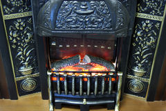 Fireplace. Not real plastic small fireplace Royalty Free Stock Image