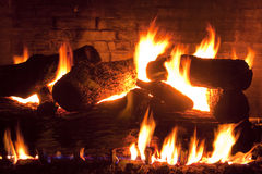Fireplace. Brick gas fireplace with logs. Long exposure Royalty Free Stock Images