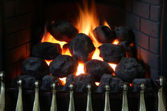 Fireplace. Domestic home gas fireplace imitating an open coal fireplace Stock Image