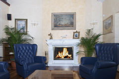 Fireplace. With fire on contemporary house Stock Images