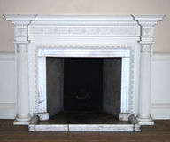Fireplace. Antique original English fireplace with ornaments Royalty Free Stock Photos