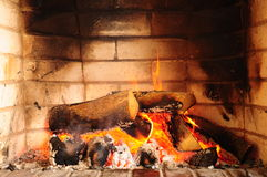 Fireplace. Flames and woods in fireplace Stock Photo