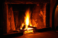 Fireplace. Fire in an old fireplace Stock Image