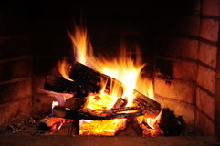 Fireplace. Yellow flames and woods in a fireplace Royalty Free Stock Photos
