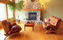 Fireplace. A west coast living room with a river rock fireplace Royalty Free Stock Images