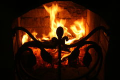 Fireplace. Live fire in the fireplace for forged fender Stock Image