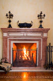 Fireplace. In a traditional fireplace, natural wood burning brightly Stock Image
