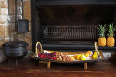 Fireplace. Fireplace in the house with all the braai tools next to it, together with a fruit platter Royalty Free Stock Image