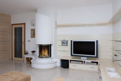 Fireplace. With round glass in white Stock Images
