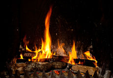 Fireplace. Burning and glowing pieces of wood in Fireplace stock image
