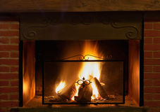 Fireplace. With flames and burning wood - detail of home interior Stock Image