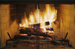 Fireplace. A Glowing Fire in a Wood Burning Fireplace royalty free stock photos