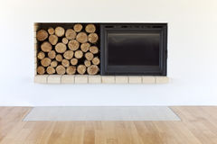 Fireplace. New fireplace with wooden logs Royalty Free Stock Image
