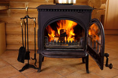 Fireplace. With flames at the house Stock Photo