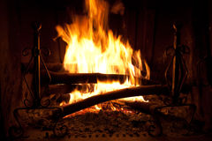 Fireplace. Dry wood burning in a fireplace with an orange flame Stock Photos