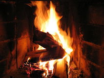 Fireplace. Burning wood in fireplace royalty free stock photo