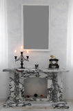 Fireplace. The fireplace revetted with marble, in an interior Royalty Free Stock Photography