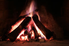 Fireplace. Logs are burning in a brick fireplace Royalty Free Stock Photo