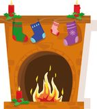 Fireplace. With christmas stockings and candles Royalty Free Stock Image