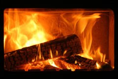 Fireplace. Flames in the fireplace from up close royalty free stock photo