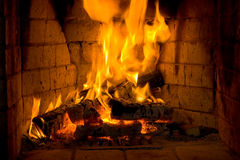 Fireplace. With a bricks. Fire is always romantic Stock Photography