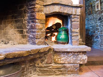 Fireplace. Picture of cosy fireplace and green pot Royalty Free Stock Images