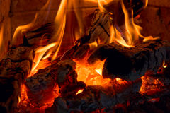 Fireplace. Fire, ashes, bricks, and soft, peaceful, romantic light Royalty Free Stock Photo