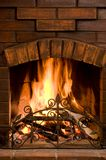 Fireplace. Close-up of bright and hot fire burning in chimney on Christmas eve Royalty Free Stock Images