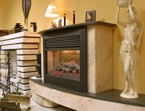 Fireplace. Interior with real classik fireplace Royalty Free Stock Photography