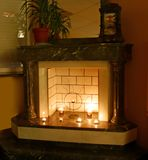Fireplace. Interior with real classik fireplace Royalty Free Stock Photo