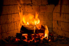 Fireplace. With log in fire Stock Photos
