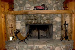 Fireplace. Rock fireplace Royalty Free Stock Photography