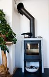 Fireplace. Indoor fireplace made from steel and stone Stock Photo