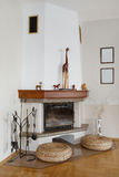 Fireplace area with seating places Stock Images