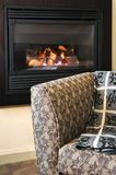 Fireplace and armchair Royalty Free Stock Photos