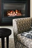 Fireplace and armchair Royalty Free Stock Photo