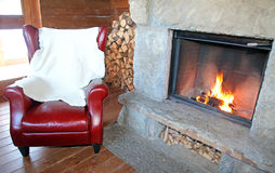 Fireplace and armchair Stock Photo