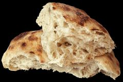Fireplace Baked Delicious Domestic Traditional Leavened Pitta Flatbread Torn Loaf Isolated On Black Background.  Stock Photography
