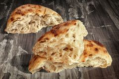 Fireplace Baked Domestic Traditional Leavened Pitta Flatbread Torn Loaves Set On Old Weathered Garden Table Grunge Surface.  Stock Photography