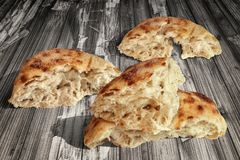 Fireplace Baked Domestic Traditional Leavened Pitta Flatbread Torn Loaves Set On Old Weathered Garden Table Grunge Surface.  Royalty Free Stock Photos