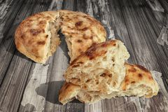 Fireplace Baked Domestic Traditional Leavened Pitta Flatbread Torn Loaves Set On Old Weathered Garden Table Grunge Surface.  Stock Photos
