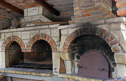 Fireplace BBQ and oven. Fireplace BBQ and oven for baking bread and whole lambs and piglets Stock Photography