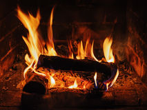 Fireplace with birch firewood and flame. Royalty Free Stock Images
