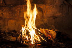Fireplace with a blazing fire. Burning wood Royalty Free Stock Photo