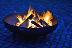 Fireplace. Blazing fire in a fire-pot royalty free stock photography