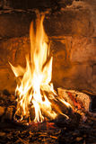 Fireplace with a blazing fire. Royalty Free Stock Photography