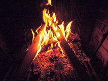 Fireplace with a blazing fire Stock Photography