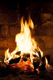 Fireplace with a blazing flamees. Royalty Free Stock Image